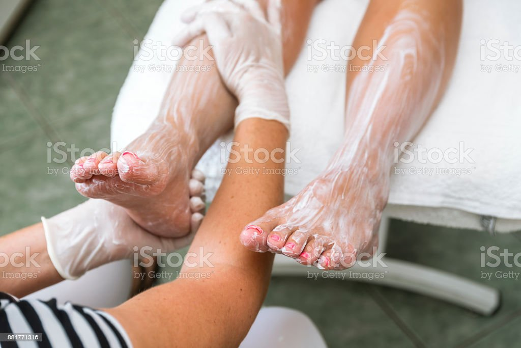 Foot treatment with cream. stock photo