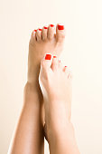Female legs with painted nails in red. on an isolated background. High quality photo