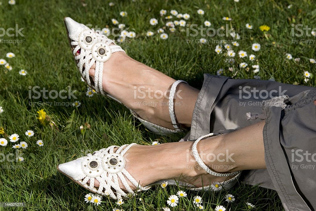 Foot with shoes on grass royalty-free stock photo