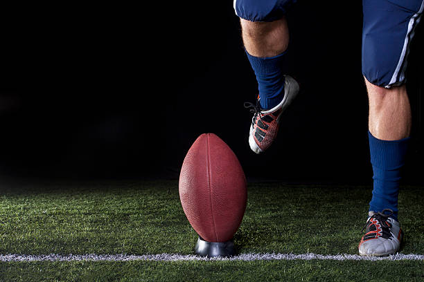 Football about to be kicked off stock photo
