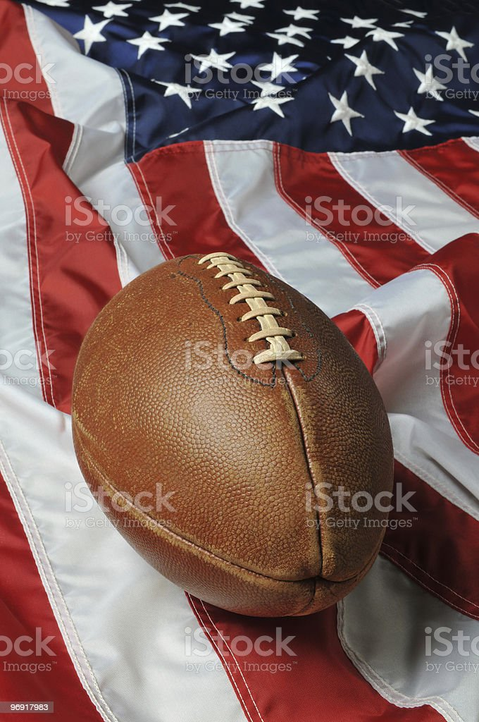 Football against an American flag royalty-free stock photo