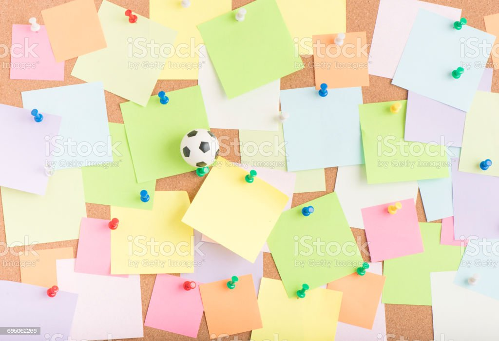 Football And Blank Sticky Notes On Notice Board In Office Royalty Free Stock Photo