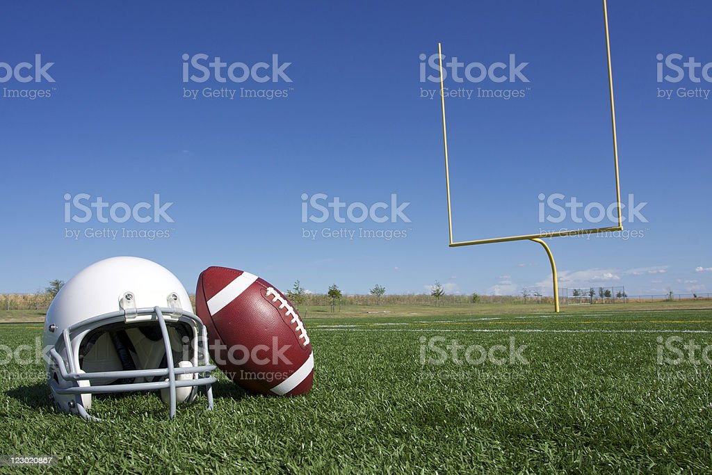Football and Helmet on the Field royalty-free stock photo