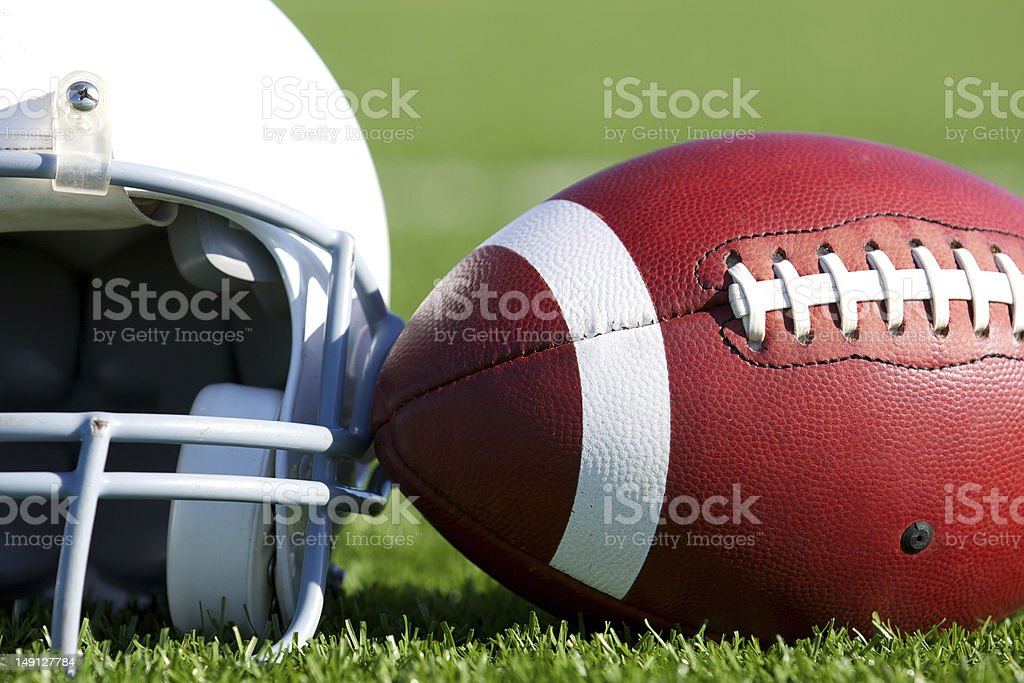 Football and Helmet on the Field stock photo