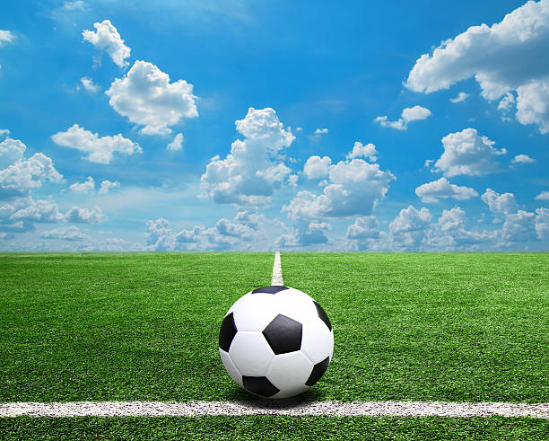 Soccer Football On Green Field With Blue Sky Background: Royalty Free Football And Soccer Field Grass Stadium Blue
