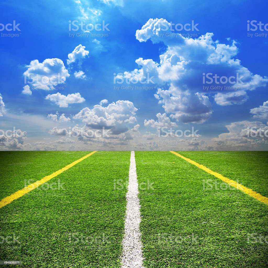 Football and soccer field grass stadium Blue sky background royalty-free stock photo