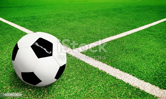 931661614 istock photo Football ball on pitch 1000800604