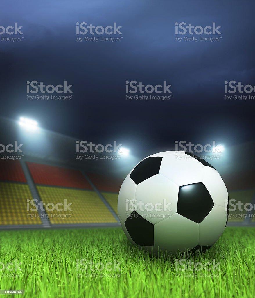 Football ball on the night stadium royalty-free stock photo