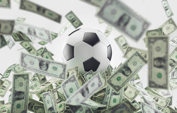 Football ball with money, soccer business stock photo