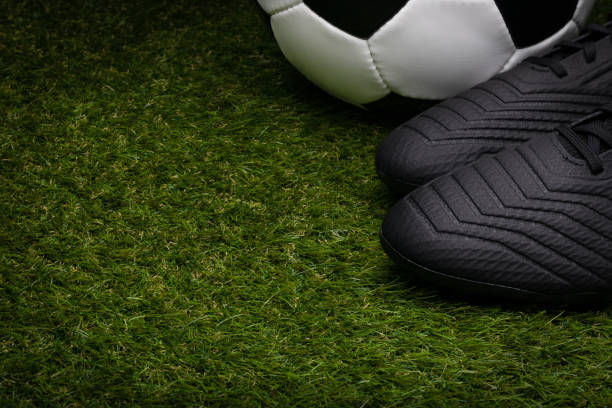 Football Boots and Football stock photo