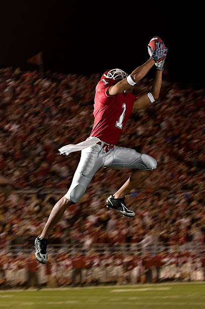 football catch - american football player stock photos and pictures