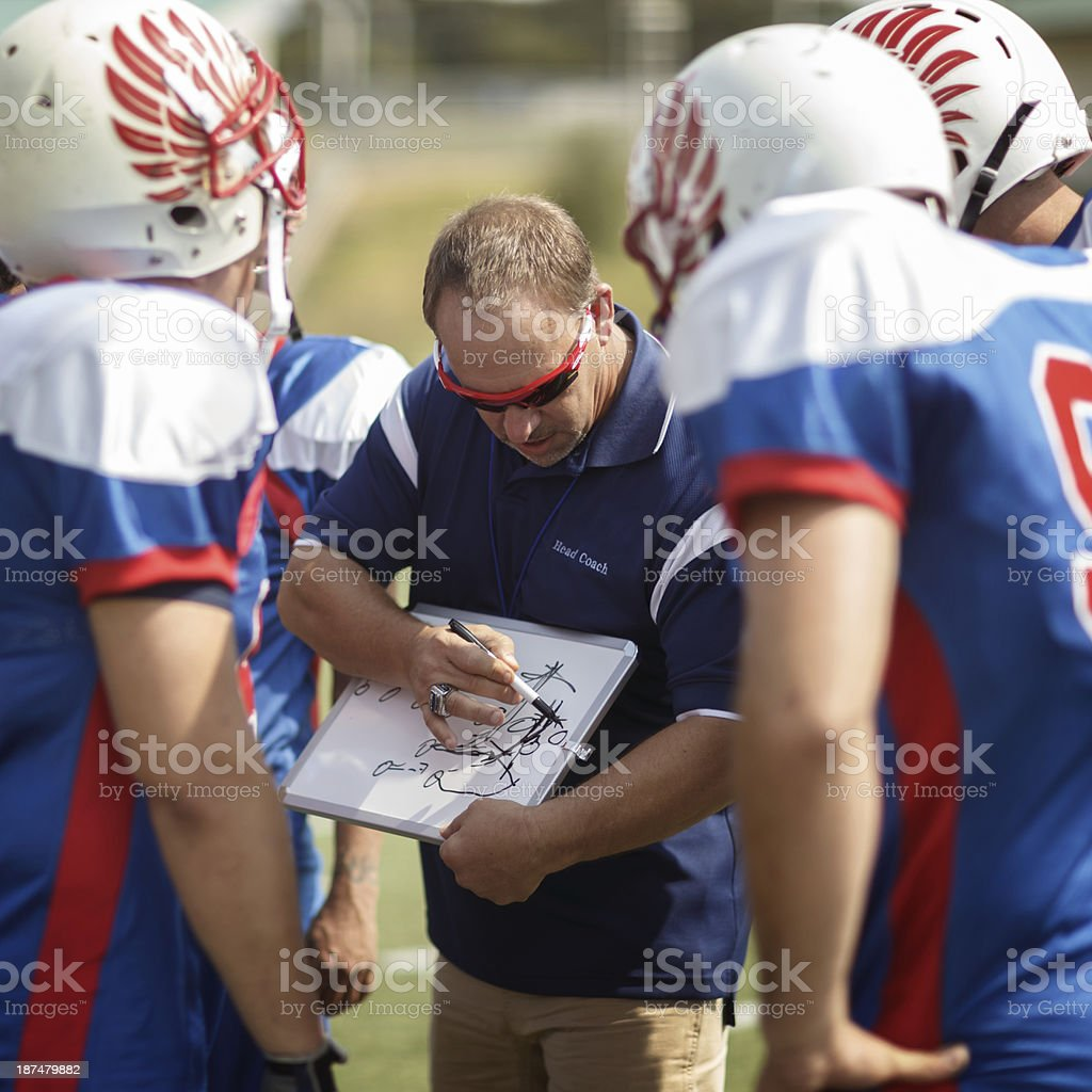 Football Coach and Players royalty-free stock photo