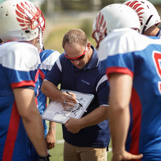 Football Coach and Players stock photo