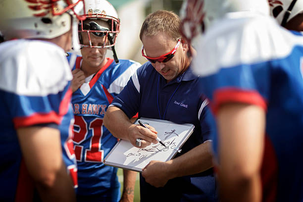 football coach and players - coach stock photos and pictures