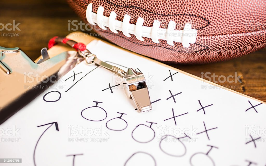 Football coach. Whistle, clipboard, desk.  School sports. stock photo