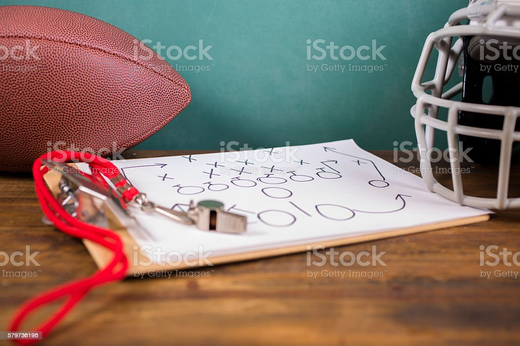 Football coach. Whistle, clipboard, helmet, school chalkboard. School sports. stock photo