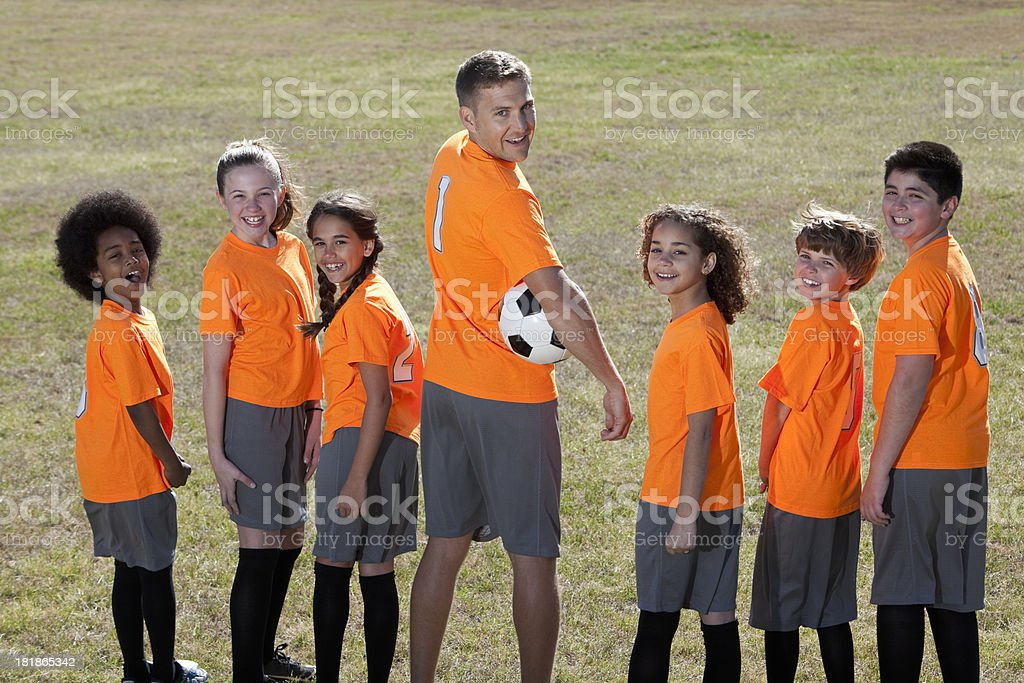 Football coach with children royalty-free stock photo