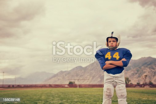 A young American Football boy dreams of taking the field.