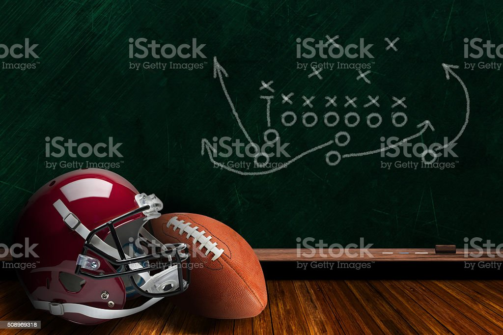 Football Equipment and Chalk Board Play Strategy Background stock photo