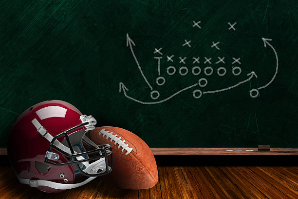 Football Equipment and Chalk Board Play Strategy Background Football helmet and ball with play strategy drawn on a background chalk board with copy space. quarterback stock pictures, royalty-free photos & images