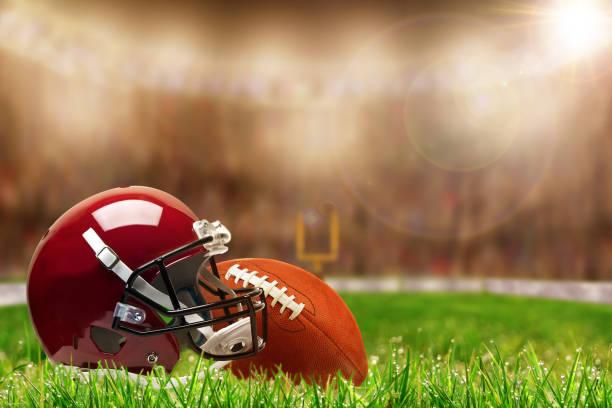 equipement de football sur herbe avec espace copie - ncaa photos et images de collection