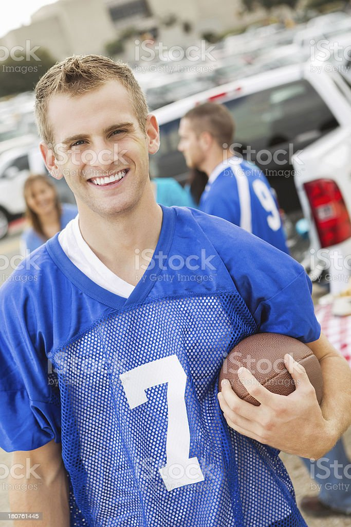 Football fan with ball at a stadium tailgate party royalty-free stock photo
