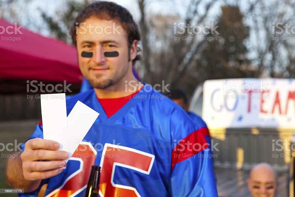 Football fan with tickets