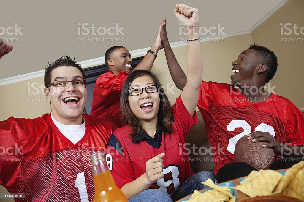 Football fans as home watching  the game on TV royalty-free stock photo