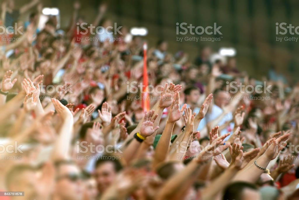 Football fans clapping on the podium of the stadium stock photo
