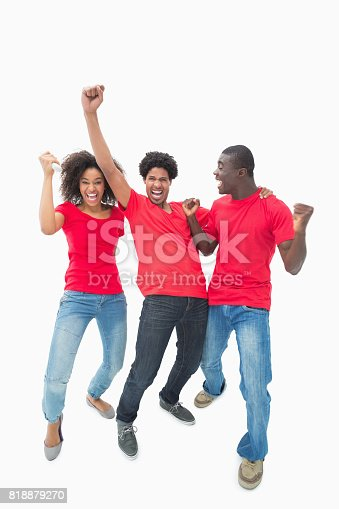 istock Football fans in red cheering together 818879270