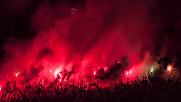 football fans lit up the lights, flares and smoke bombs - adeptos imagens e fotografias de stock