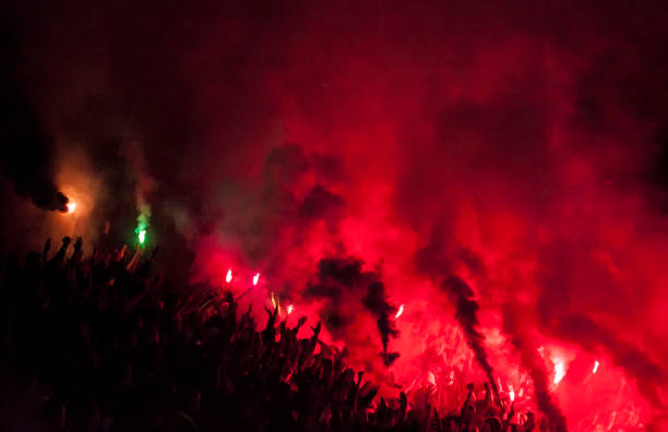 Football fans lit up the lights, flares and smoke bombs Football fans lit up the lights, flares and smoke bombsFootball fans lit up the lights, flares and smoke bombs pyrotechnic effects stock pictures, royalty-free photos & images