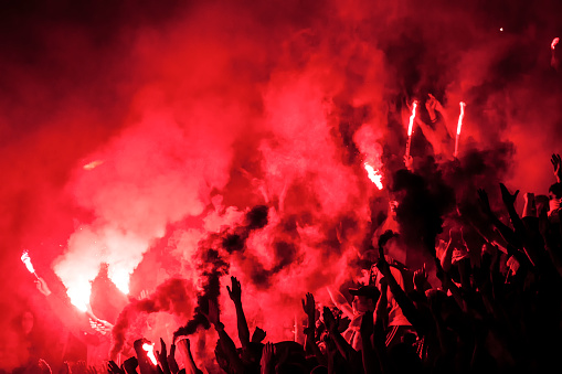 Football fans lit up the lights, flares and smoke bombs. Protest concept.Football fans lit up the lights, flares and smoke bombs