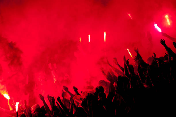 Football fans lit up the lights, flares and smoke bombs Football fans lit up the lights, flares and smoke bombs. Protest concept.Football fans lit up the lights, flares and smoke bombs pyrotechnic effects stock pictures, royalty-free photos & images