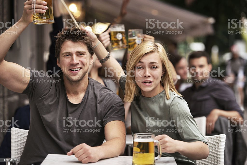 Football fans on sidewalk bar stock photo
