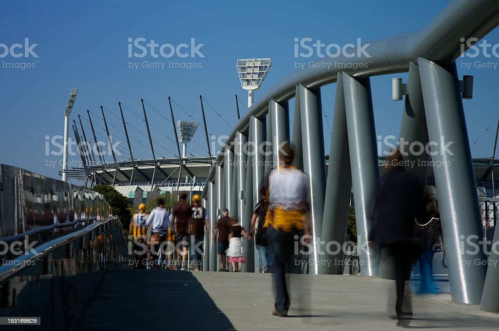 Football fans on their way to MCG stock photo