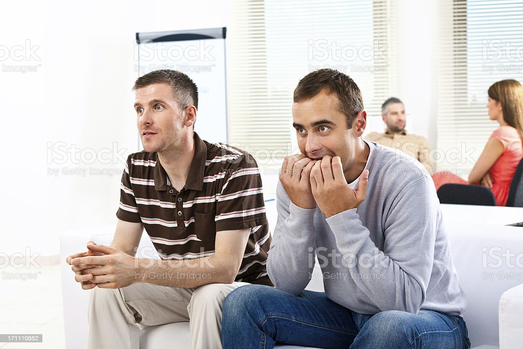 Football fans Creative agency. Two excited adult man watching football match during a break at work. 30-34 Years Stock Photo