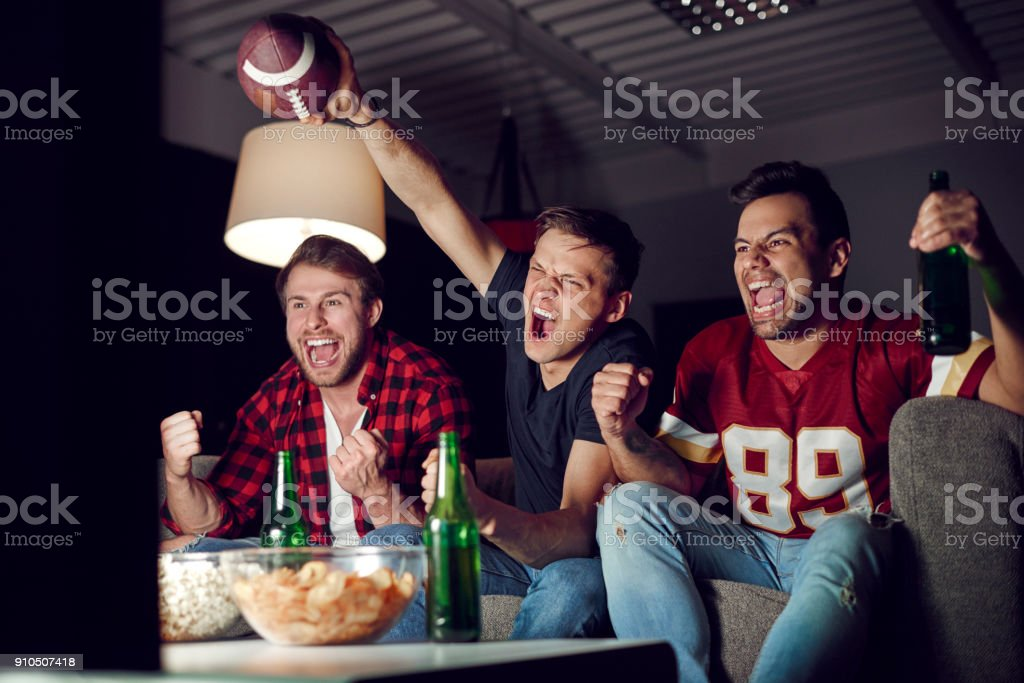 Football fans shouting and gesturing stock photo
