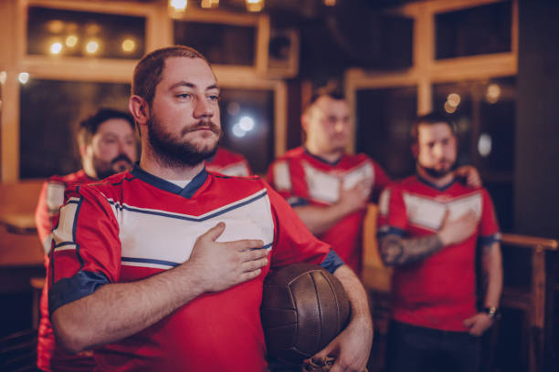 football fans singing national anthem - national anthem stock photos and pictures