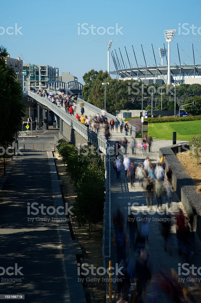 Football fans walking to the MCG stock photo