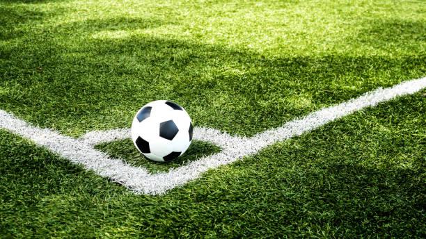 football field  ball on green grass , soccer field  background texture stock photo