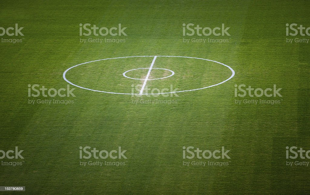 football field centre lines on green grass stock photo