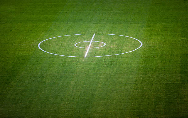 football field centre lines on green grass - target australia stock pictures, royalty-free photos & images