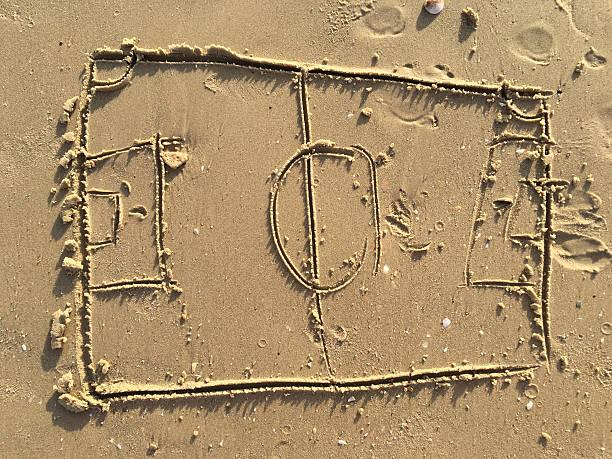 football field drawing on sand beach. - futebol de areia - fotografias e filmes do acervo