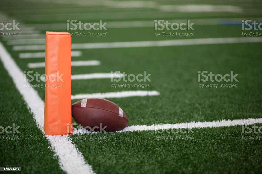 Football field end zone ball stock photo