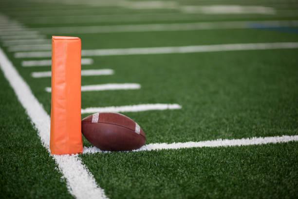 Football field end zone ball stock photo