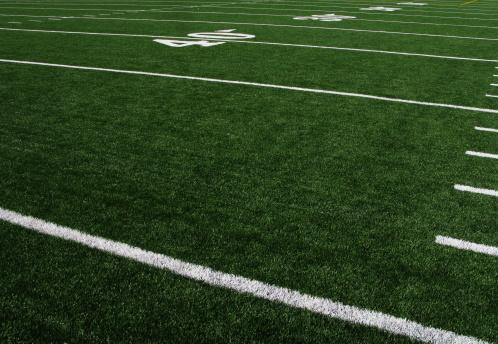A view of an artificial turf football field.