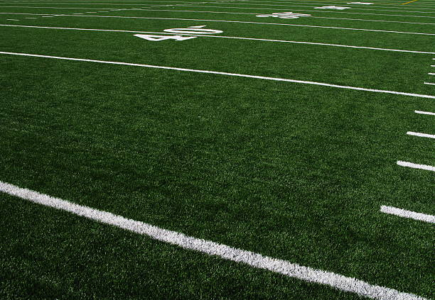 Football Field Forty Yardline Artificial Turf A view of an artificial turf football field. soccer field stock pictures, royalty-free photos & images