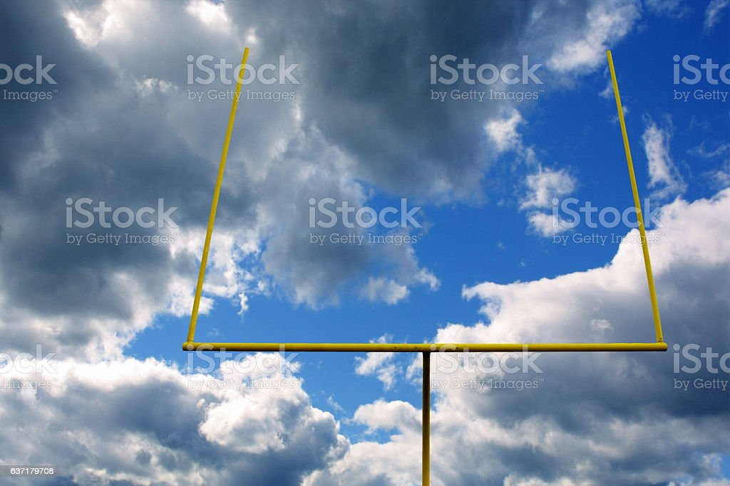 Football Field Goal with Clouds and Yellow Post stock photo