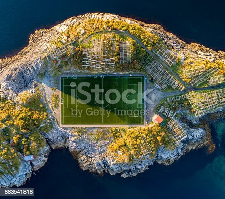 Football field in Henningsvaer from above. Henningsvaer is a fishing village located on several small islands in the Lofoten archipelago in Norway.